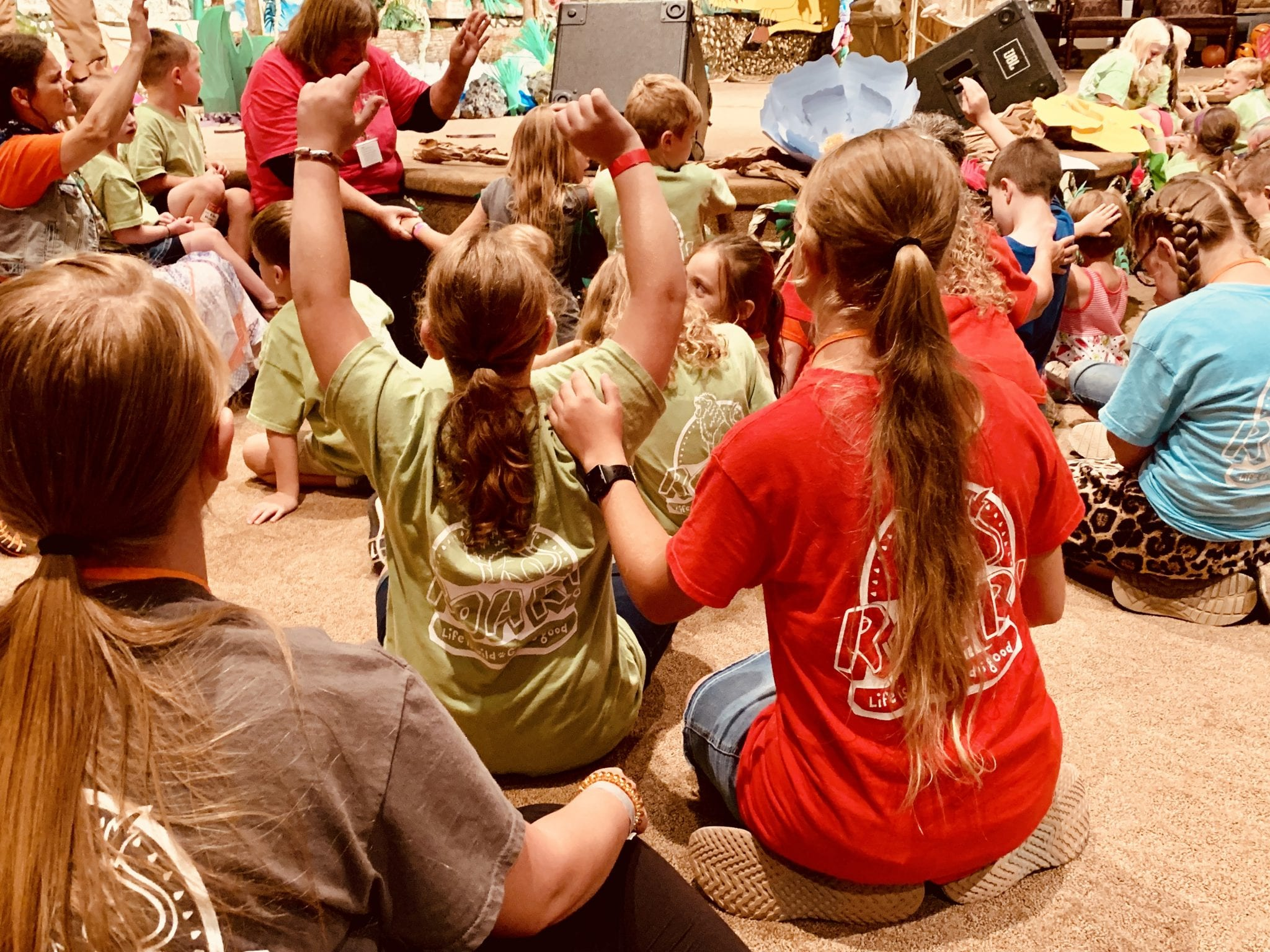 children worshipping and praying during Roar Vacation Bible School at Christ Community Church The Pentecostals - Henderson, TN